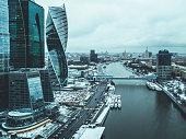 """aerial drone shot of the city skyscraper near the river and bridge during winter""""t""""n"""