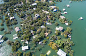 Historic Flooding in Central Texas Homes under water at Graveyard Point neighborhood community in the flood plain of Lake Travis , Aerial drone view entire Neighborhood under water near Austin , Texas