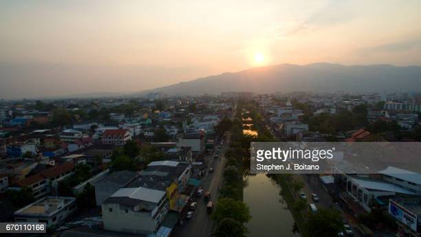 Aerial drone view of sunset over the moat in the Old City of Thailand' second largest city Chiang Mai