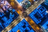 Aerial drone view on city intersection during winter night in Gliwice, Silesia, Poland