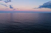 Aerial image moon over ocean purple sunset twilight