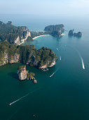 Aerial photo of Ao Nang beach in Krabi, Thailand. Thailand landscape with beach, green rocks, sand and boats on the sea.