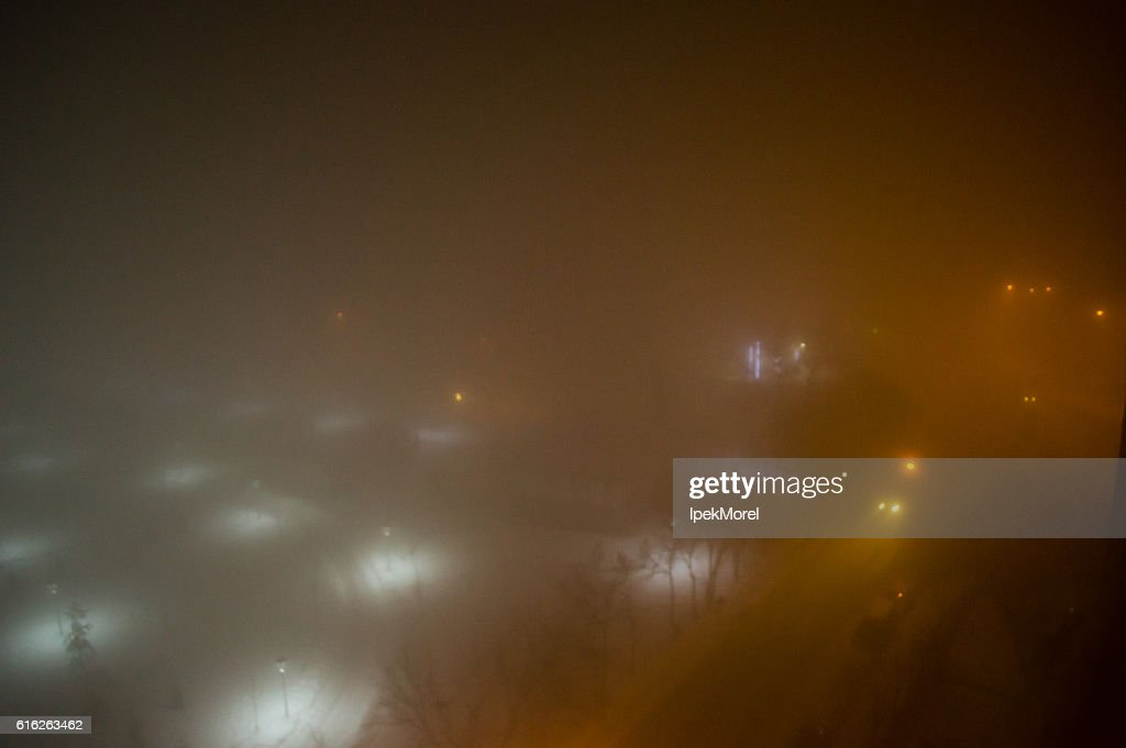 Aerial Night View of a Lighted Foggy Street : Stock Photo