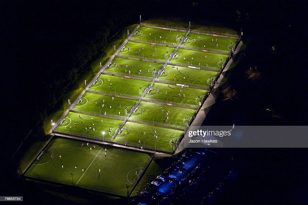 Aerial night view of an unspecified floodlit astro turf football pitches on August 6, 2007 in London.