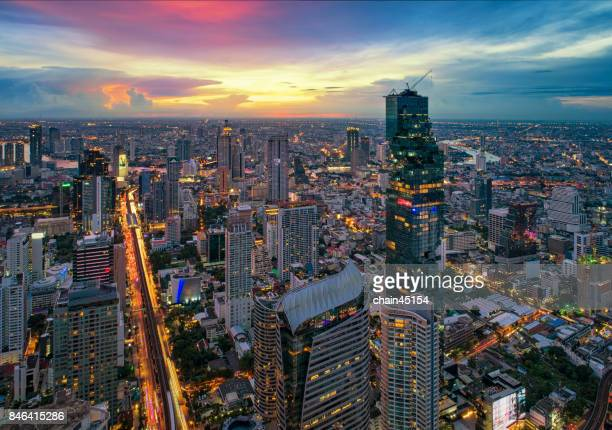 Aerial of Bangkok modern office buildings in Bangkok city downtown with sunset sky with BTS sky train. Bangkok is the most populated city in Southeast Asia.