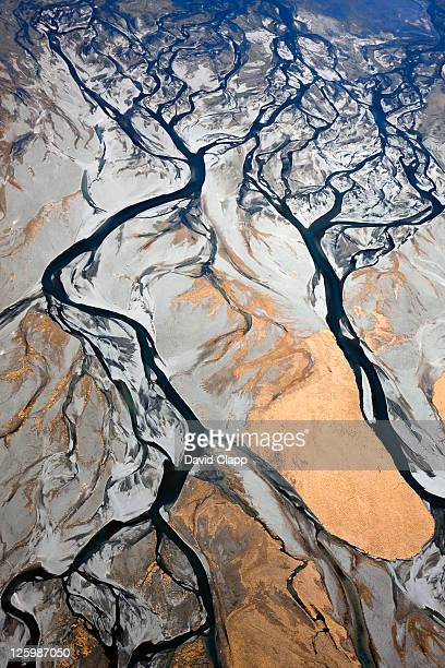 Aerial of braided, glacial river channels flowing into other where Godley River joins Lake Tekapo, Southern Alps, New Zealand