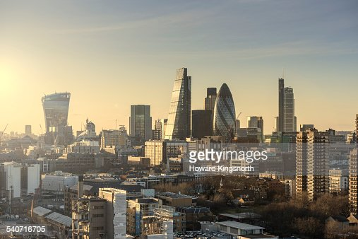 Aerial of City of London at sunset looking west
