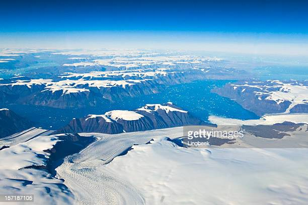 Aerial of Greenland glaciers and icebergs