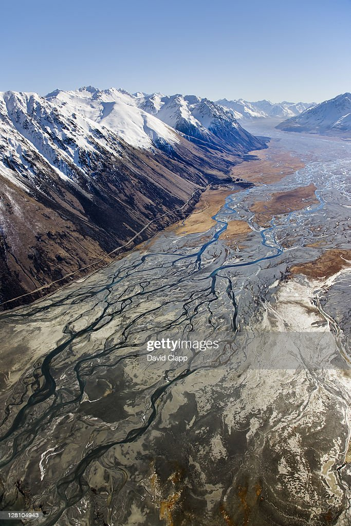 Aerial of Hall Mountain Range bordering braided glacial waters of Godley River and Lake Tekapo, South Island, New Zealand : Stock Photo