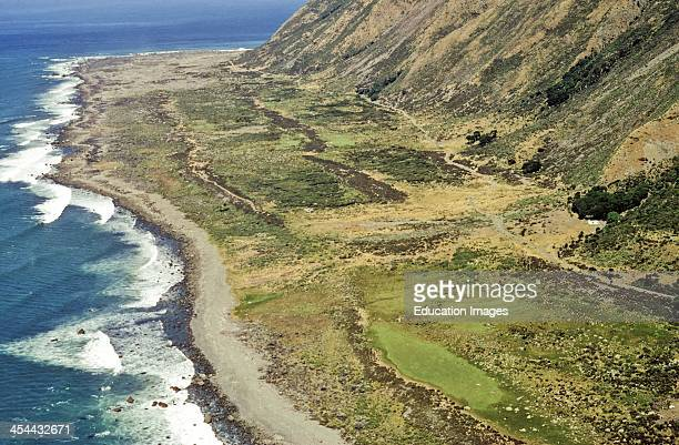 Aerial of world famous raised beaches 1855 earthquake scree cover Horizontal movement much greater Coastal uplift Aerial north of Cape Turakirae...