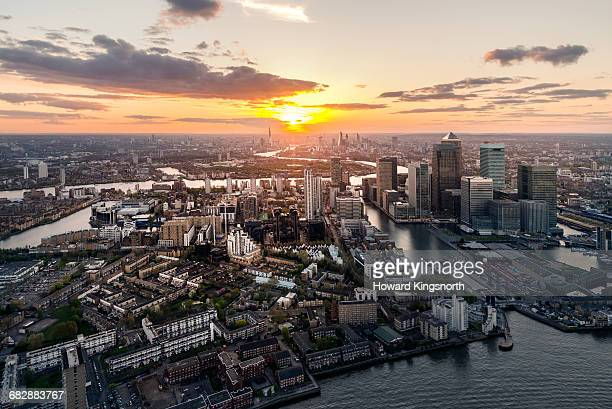 Aerial over Canary Wharf and the Thames at sunset