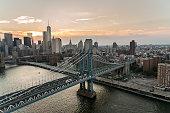 Aerial over East River of Manhattan Bridge
