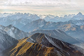Aerial panorama of mountain range and snowy mountain peaks