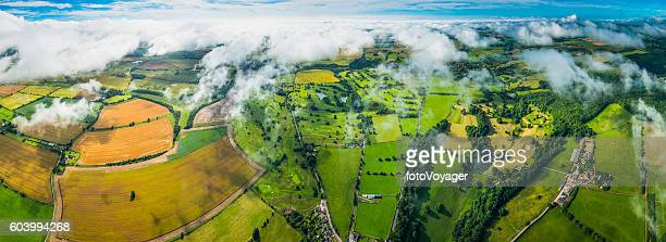 Aerial panorama over patchwork quilt rural landscape fields farms pasture