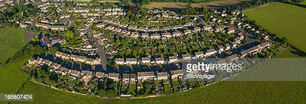 Aerial panorama over summer suburban streets gardens
