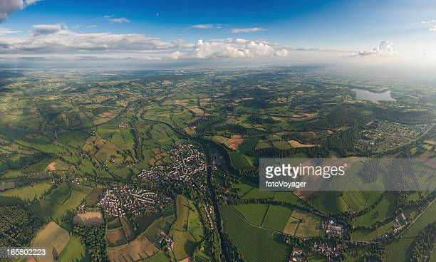 aerial panorama patchwork landscape green fields farms villages