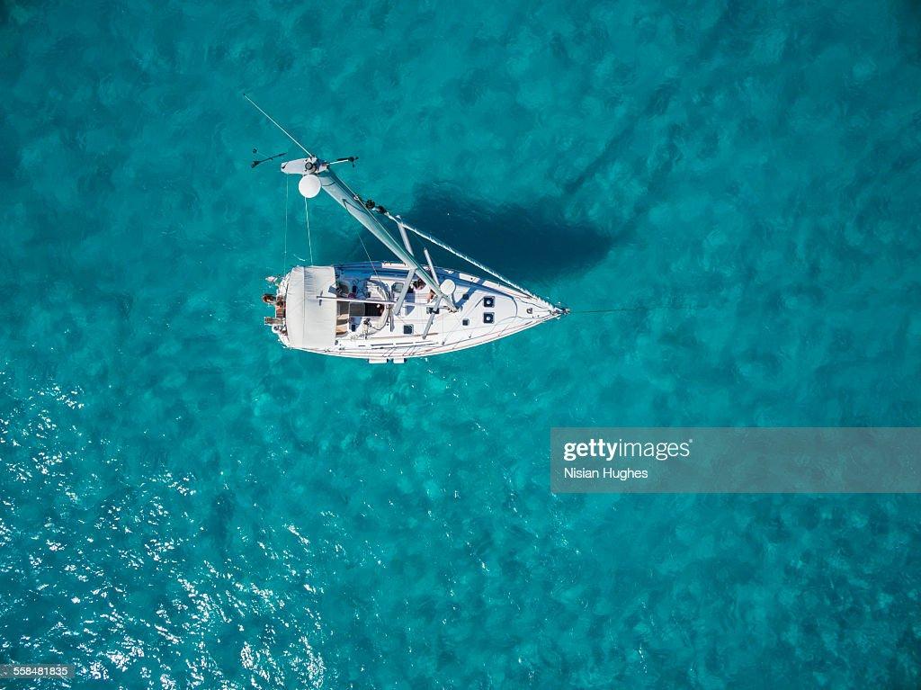 Aerial photo of sailboat anchored : Stock Photo