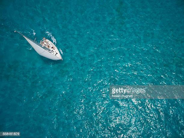 Aerial photo of sailboat sailing beautiful ocean