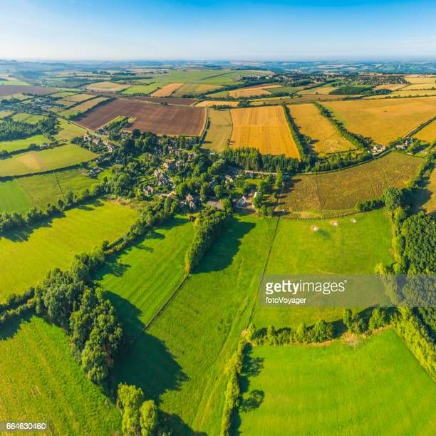 Aerial photograph over green pasture crop fields farms country villages