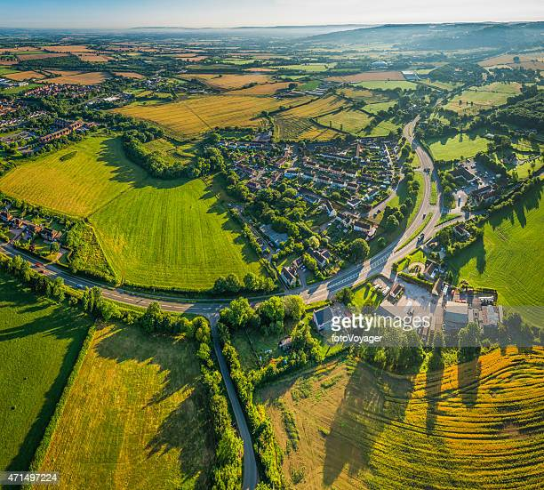 Aerial photograph over suburban villages country farms fields and pasture