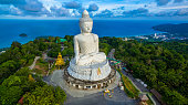 aerial photography white great Phuket's big Buddha in blue sky. Phuket's Big Buddha is one of the island's most important and revered landmarks on the island.