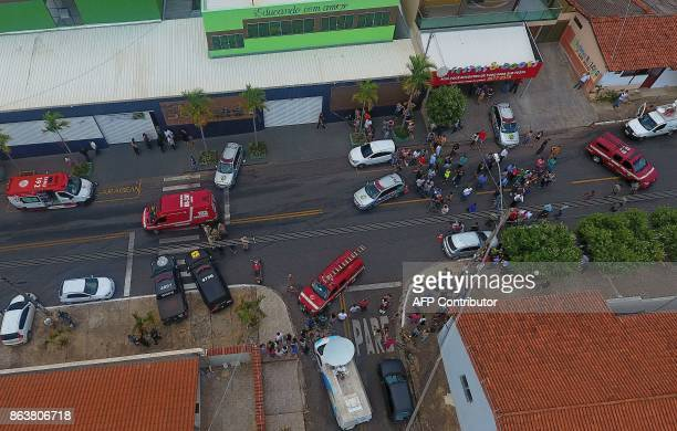 Aerial picture released by Brazilian newspaper O Popular people gathering outside the Goyases private school in Goiania in the central Brazilian...