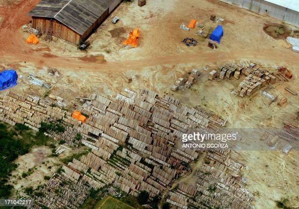 Aerial picture taken 26 February 2005 of piles of wood awaiting for transportation at a sawmill near Amapu Amazonian rain forest 600 km from Belem...