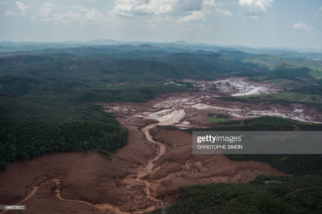Aerial picture taken on November 6 2015 a day after dam burst in Bento Rodrigues a village of some 600 people near the Brazilian southeastern city of...