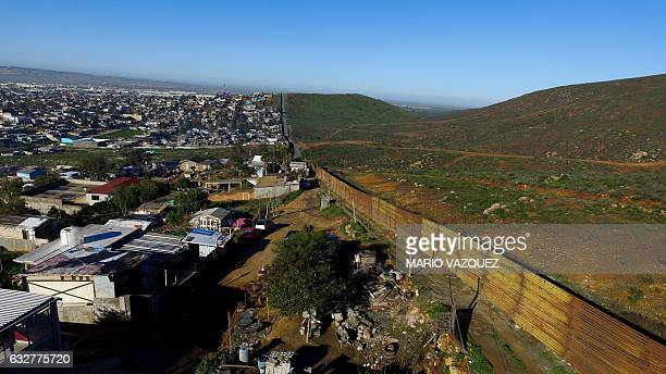 Aerial picture taken with a drone of the urban fencing on the border between the US and Mexico at El Nido del Aguila outskirts of Tijuana...