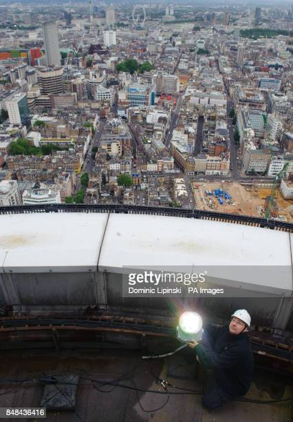 BT Aerial Rigger Mark Gravett adjusts lights on the top of the BT Tower in central London which will be illuminated gold to mark Team GB athletes...