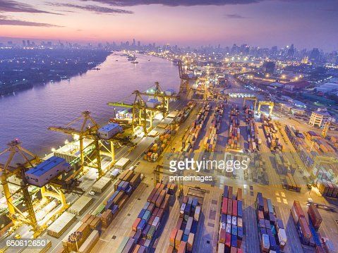 Aerial shot Container Cargo freight ship with working crane bridge in shipyard : Bildbanksbilder