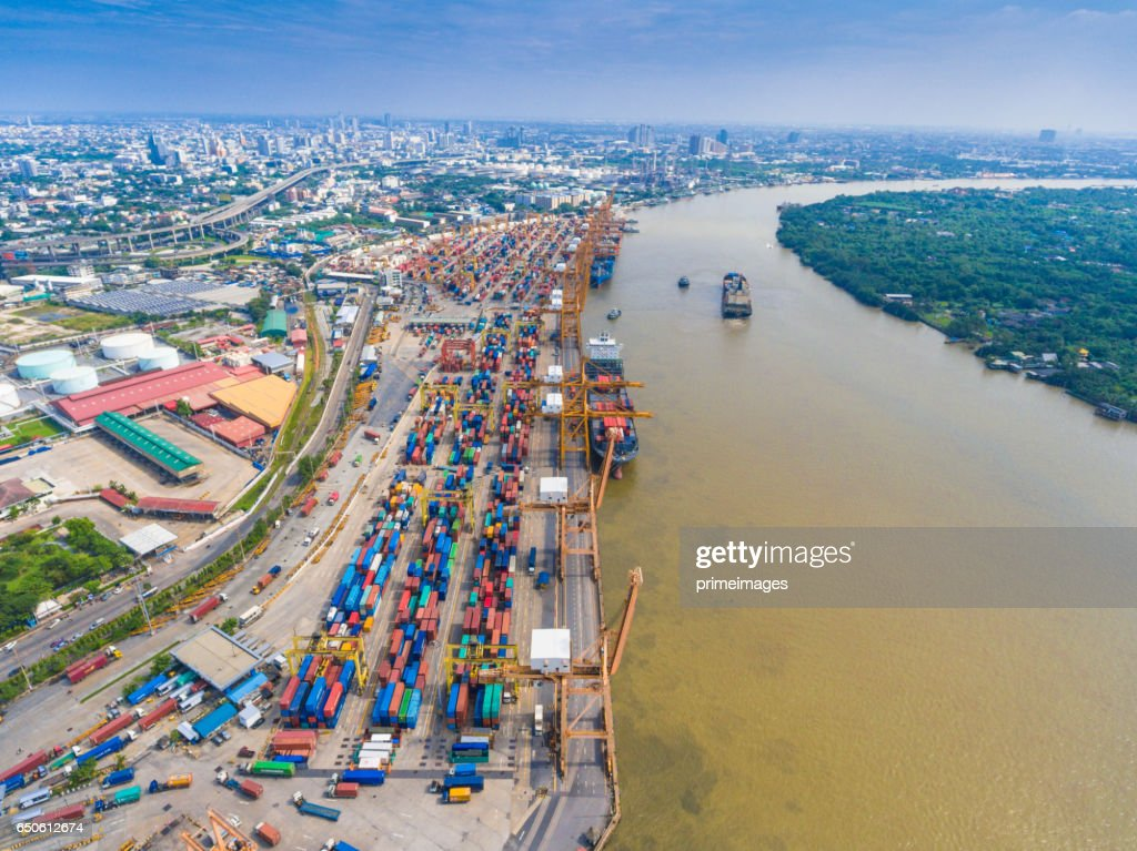 Aerial shot Container Cargo freight ship with working crane bridge in shipyard : Stockfoto