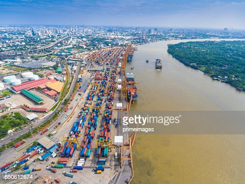 Aerial shot Container Cargo freight ship with working crane bridge in shipyard : Stock Photo