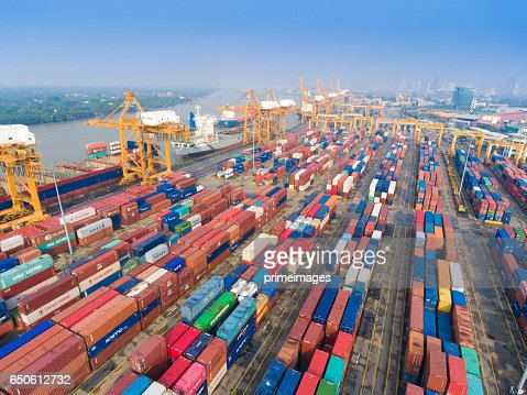 Aerial shot Container Cargo freight ship with working crane bridge in shipyard : ストックフォト