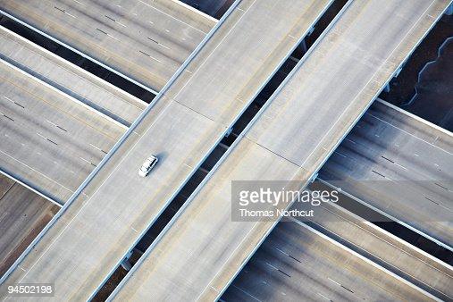Aerial shot of one car on freeway