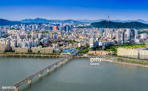 Aerial shot of Seoul City Skyline and N Seoul Tower with traffic bridge, South Korea.