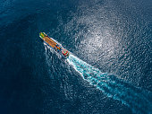 Aerial shot of the cargo ship moving in the ocean