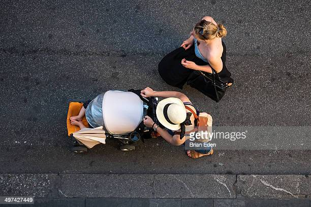 Aerial shot of two women with a stroller in Rome