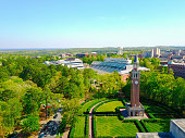 Aerial shot at UNC of the campus bell tower and football stadium.