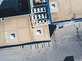 aerial top view of industrial technical system machines on the rooftop of hangar building