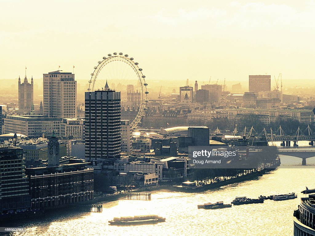 Aerial view across the River Thames, London, UK