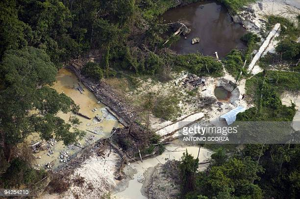 Aerial view af an area devastated by clandestine gold mining in the Jamanxim National Forest state of Para northern Brazil November 29 2009 With 13...