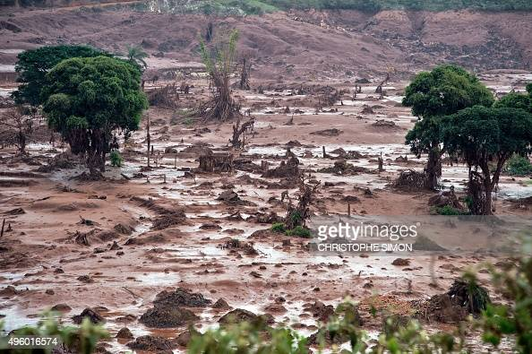 Aerial view after a dam burst in the village of Bento Rodrigues in Mariana Minas Gerais state Brazil on November 6 2015 A dam burst at a mining waste...