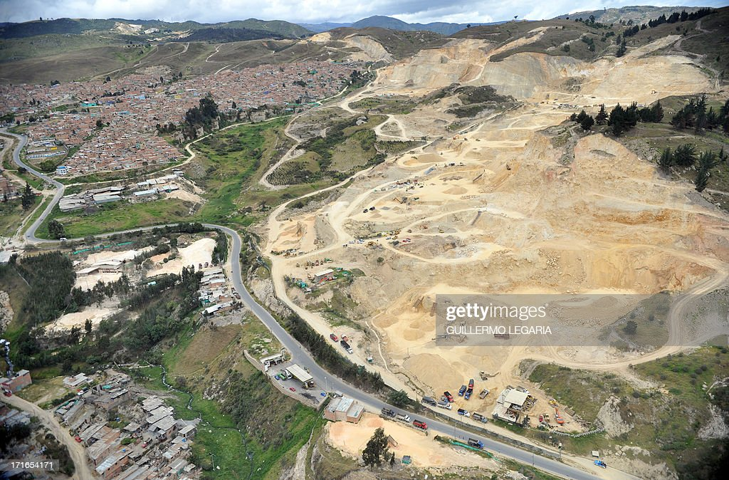 Aerial view air of a gravel, sand and stone quarry in the municipality of Soacha, outskirts of Bogota, on June 27, 2013. In a joint Police-Justice Department-Ministry of Environment of Bogota raid against illegal mining, ten people were arrested and machinery confiscated. AFP PHOTO/Guillermo LEGARIA