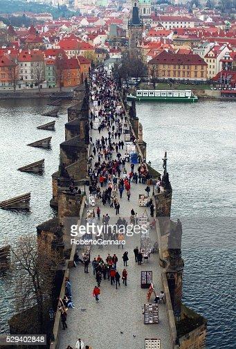 Aerial view Charles bridge Prague walking tourists Hradcany