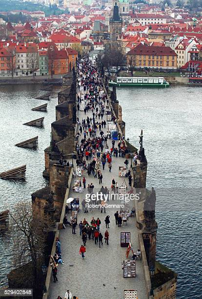 Aerial view Charles bridge Prague walking tourists Hradcany