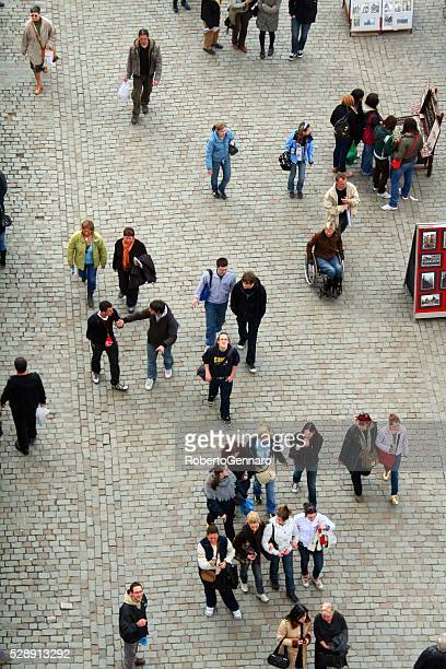 Aerial view Charles bridge Prague walking tourists