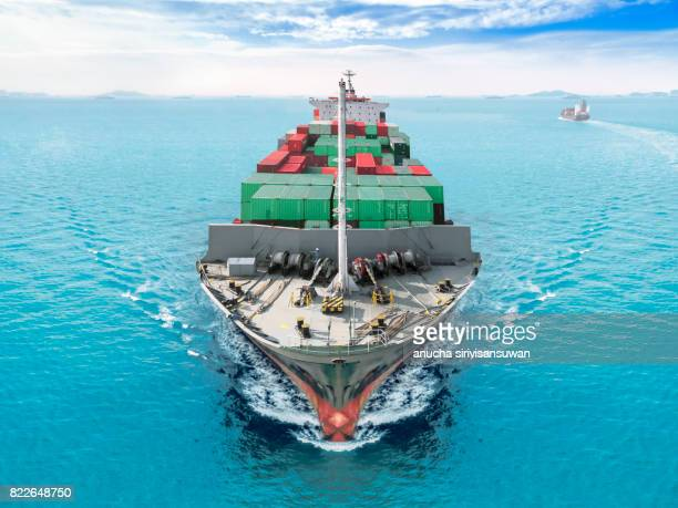 aerial view container ship or cargo vessel sailing ship at sea at blue sky .