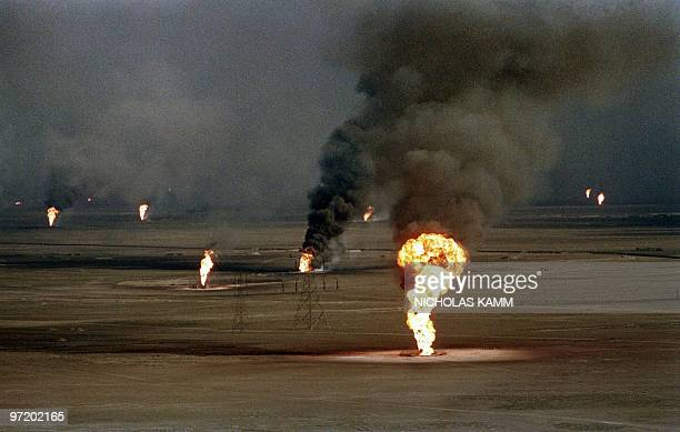 Aerial view dated 14 March 1991 of burning oil wells damaged by retreating Iraqi soldiers in AlAhmadi oil field in southern Kuwait In 1991 Iraqi...
