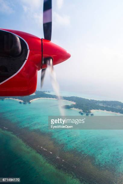 Aerial View from a Seaplane of Trans Maldivian Airways at Ring Reefs and Islands in the Indian Ocean on February 23 2017 in Male Maldives